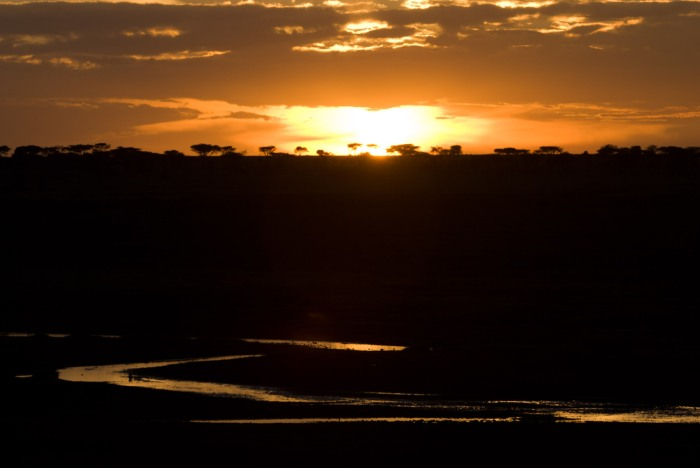 Ngorongoro Conservation Area: sunset reflecting on water