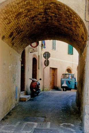 In Asciano, an arched entrance to a narrow street.