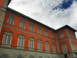 Orange building along the Arno.
