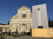 For the cache, I needed to see the bottom of the two obelisks in Piazza di Santa Maria Novella. Fortunately, the screens around the renovation in progress showed enough detail for me to answer the question.