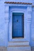 Blue door, blue frame, blue wall.