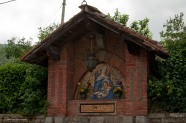 A wall shrine opposite the gas station.
