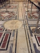 The disc of marble and meridian line, inset into the floor.