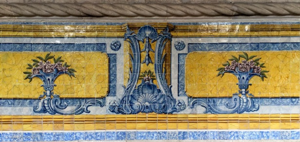 Decorative tile in the refectory; note the stone 'rope.'