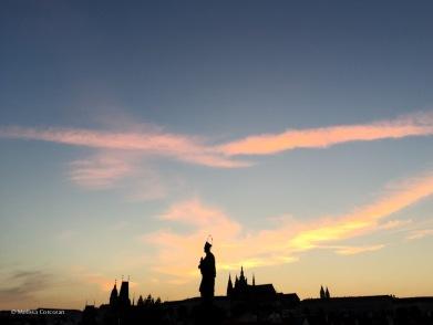 Silhouette of a statue on the bridge.