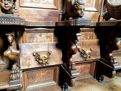 Two of the choir stalls. All of the stalls have different carvings.