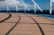Shadows on the deck in front of the bridge.