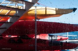 Two crew members were washing the windows of the library on deck four when I captured this image.