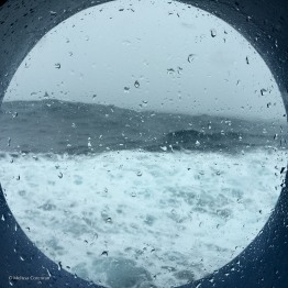 The view through a porthole on deck two on a day when the waves were high.
