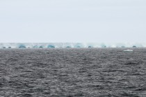 A tabular iceberg; its length was measured in miles.