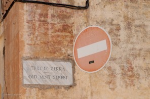 A street sign in Maltese and English.